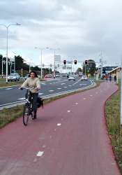 Wide cycle path alongside very large busy road